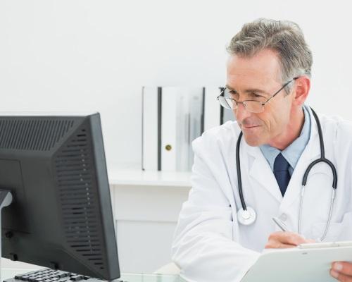 Doctor looking at computer monitor
