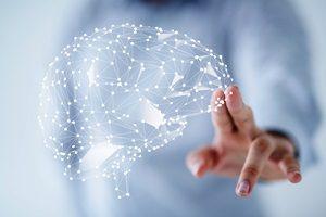 man hand drawing a virtual brain